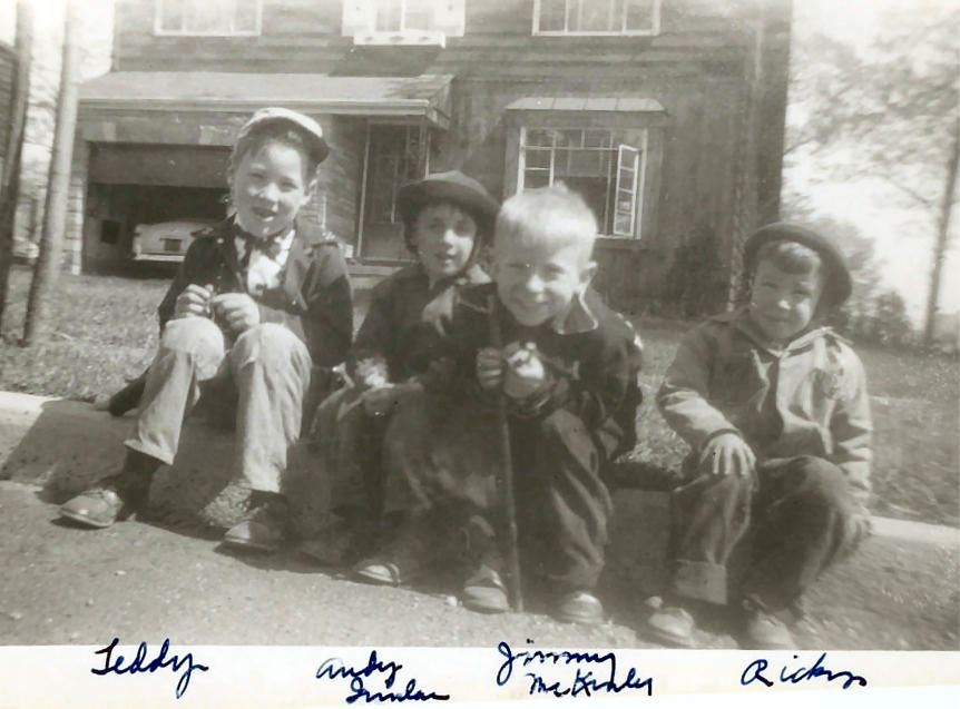 Teddy, Andy Quinlan, Jimmy McKinley, and Ricky sittin' on the curb.