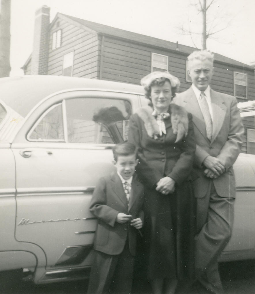 Ricky, Mom and Dad in front of our 1948 Ford Mercury, 1954.